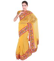 Yellow plain net  saree with blouse
