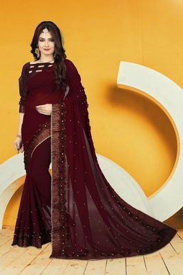 Brown embroidered georgette saree with blouse
