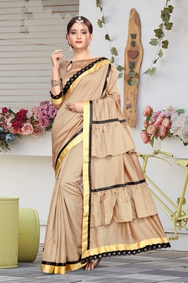 Beige embroidered pure silk saree with blouse