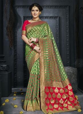 Green woven art silk blend saree with blouse