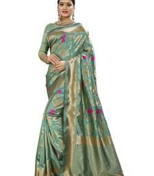 Green woven banarasi and jacquard saree with blouse