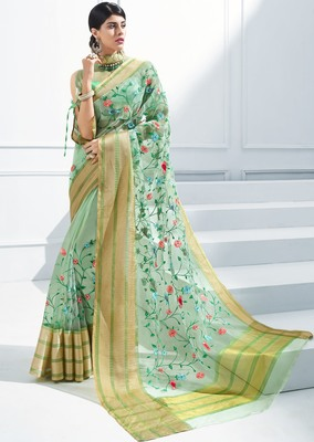 Green embroidered tissue saree with blouse