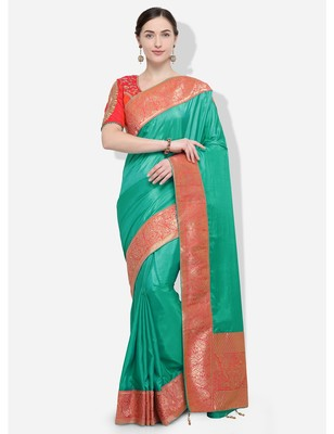 Green and gold woven silk blend saree with blouse