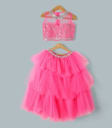 bright pink frilly sirt with embroiderd top