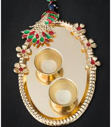 Elegant elements handcrafted golden peacock cut work pooja thali