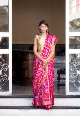 Magenta silk checked bandani print saree with heavy zari