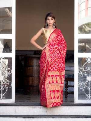 Red art silk saree with zari weaves and heavy pallu