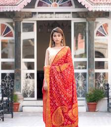 Dark red (maroon) art silk saree with zari weaves and heavy pallu