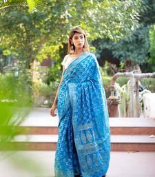Blue art silk saree with silver blouse