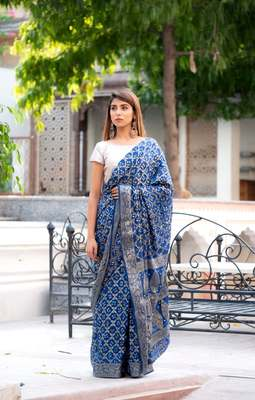 Navy blue art silk saree within silver blouse