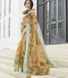 Yellow printed organza saree with blouse