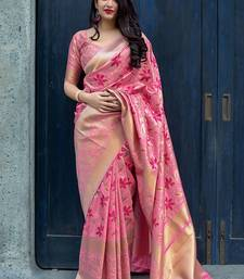 Pink woven banarasi silk blend saree with blouse