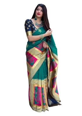 Sea green woven banarasi silk blend saree with blouse