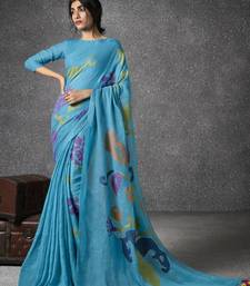 Aqua blue woven linen saree with blouse