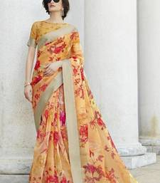 Peach printed organza saree with blouse