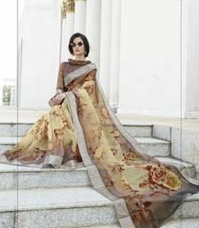 Brown printed organza saree with blouse