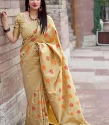 Cream woven banarasi silk blend saree with blouse