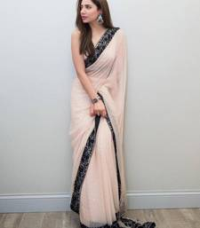 Light peach embroidered georgette saree with blouse