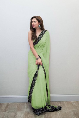 Parrot green embroidered georgette saree with blouse