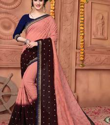 Light red embroidered silk saree with blouse