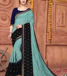 Light multicolor embroidered silk saree with blouse