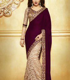 Brown  -  Cream embroidered velvet saree with blouse