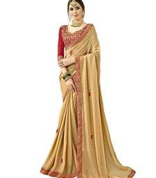 Beige embroidered shimmer saree with blouse