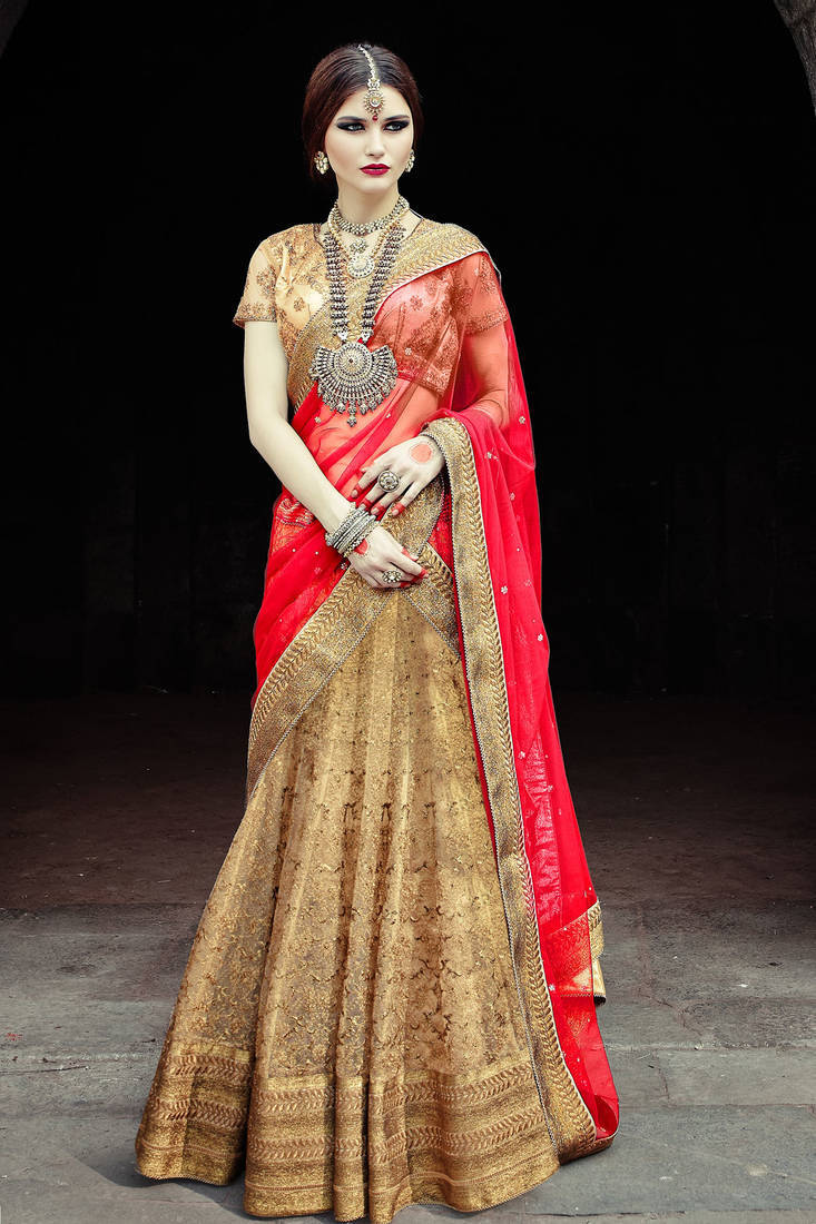 Buy Golden Choli With Embroideried Net Flared Lehenga Online