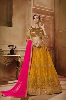 253356e19b161 Yellow embroidered net semi stitched lehenga with dupatta. Shop Now