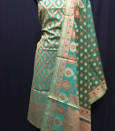 Green weaved cotton silk unstitched salwar with dupatta