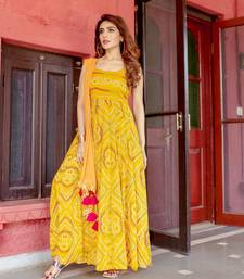 mustard embroidered Crepe Silk kurtis