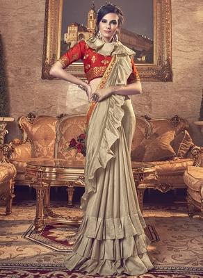 Beige plain art silk ruffle saree with blouse