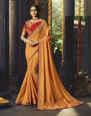 Orange embroidered silk cotton saree with blouse