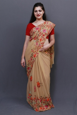 Elegant Fawn Colour Saree With Dense Aari Jaal On Pallu And Flowral Motifs.