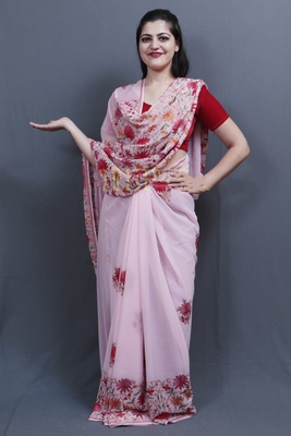 Baby Pink Colour Saree With Dense Aari Jaal On Pallu And Flowral Motifs.