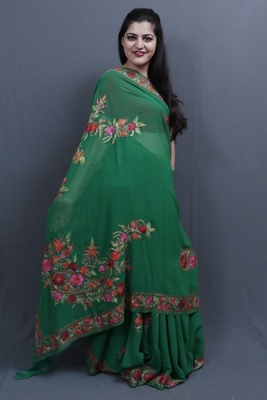 Green Colour Saree With Aari Work Border And Bold Paisleys Make The Saree Unique And Attractive