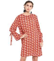 Orange floral print crepe dresses
