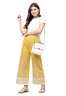 Ishin Women's Cotton Yellow Solid Flared Palazzos