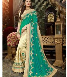 Multicolor embroidered art silk saree with blouse
