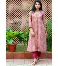 A classic brown coloured kurta with exotic gota patti work