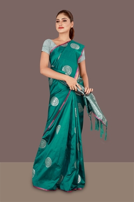dark green woven art silk banarasi saree with blouse piece