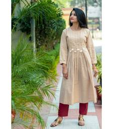 Beige coloured kurta with pearl work