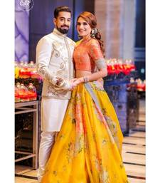 Yellow embroidered organza unstitched lehenga with dupatta
