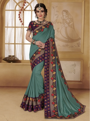 Turquoise woven faux chiffon saree with blouse