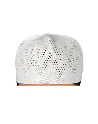 white islamic prayer cap with dotted zig zag pattern