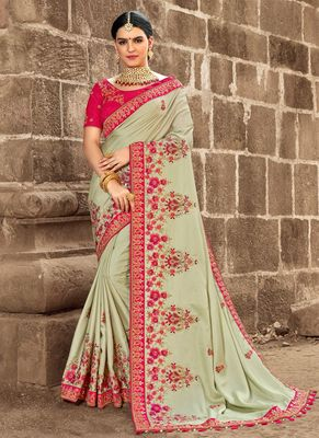 Olive embroidered georgette saree with blouse