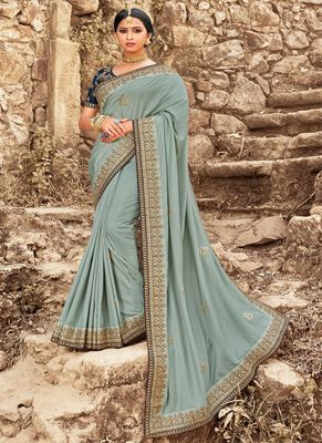 Light olive embroidered georgette saree with blouse