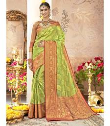 Light green woven tissue saree with blouse