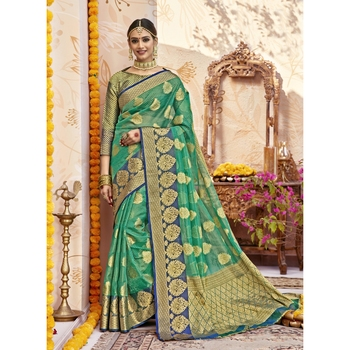 Sea green woven tissue saree with blouse