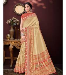 golden embroidered banarasi silk saree with blouse